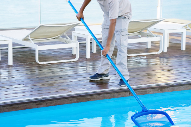 pool-cleaner-during-his-work_156719-43